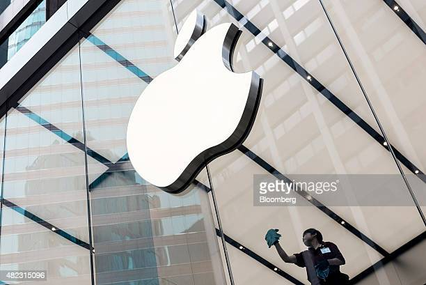 An employee cleans a window at Apple Inc's new Canton Road store in the Tsim Sha Tsui district of Hong Kong China on Thursday July 30 2015 Apple...