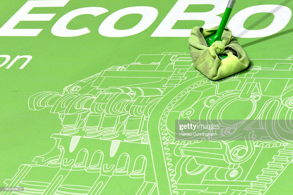 An employee cleans an eco engine sketch car during the 83rd Geneva Motor Show on March 6, 2013 in Geneva, Switzerland. Held annually with more than 130 product premiers from the auto industry unveiled this year, the Geneva Motor Show is one of the world's five most important auto shows.