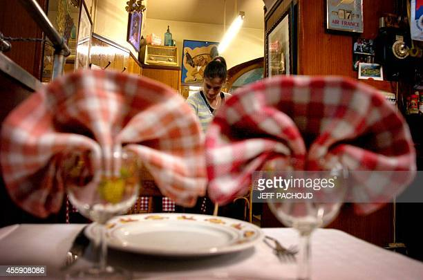 An employee cleans the floor at a 'bouchon' restaurant 07 November 2006 in Lyon southern France The name of the typical Lyonnais eating...