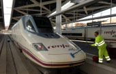 An employee cleans the front of an Alta Velocidad Espanola highspeed train operated by RENFE at Joaquin Sorolla railway station in Valencia Spain on...