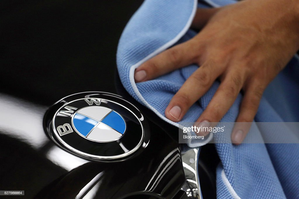 An employee cleans the hood of a BMW AG X5 vehicle on the production line at a BMW manufacturing plant in Pluak Daeng, Rayong Province, Thailand, on Tuesday, May 3, 2016. BMW's profit declined 2.5 percent in the first quarter on investment in new technologies like self-driving cars to defend its status as the world's biggest maker of luxury vehicles. Photographer: Dario Pignatelli/Bloomberg via Getty Images