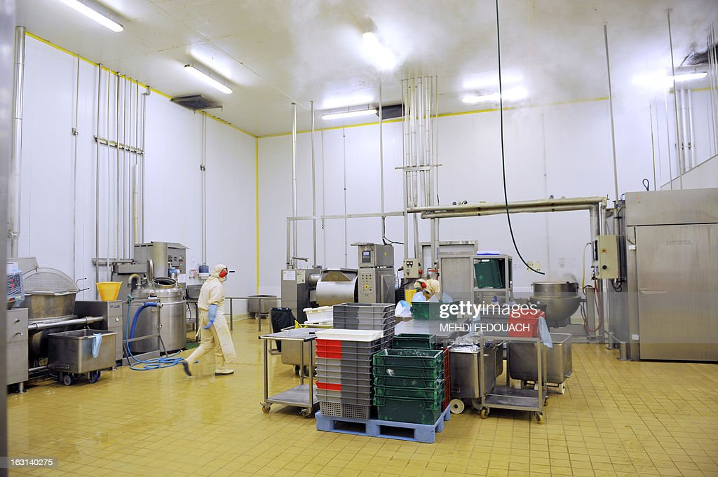 An employee cleans the kitchen of French ready made meals company 'Delpeyrat Traiteur' on March 4, 2013 in Agen, southwestern France.