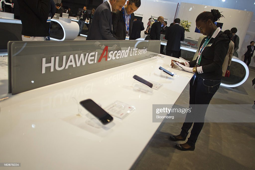 An employee cleans the screen of a Huawei Technologies Co. Ascend G526 smartphone at the Mobile World Congress in Barcelona, Spain, on Monday, Feb. 25, 2013. The Mobile World Congress, where 1,500 exhibitors converge to discuss the future of wireless communication, is a global showcase for the mobile technology industry and runs from Feb. 25 through Feb. 28. Photographer: Angel Navarrete/Bloomberg via Getty Images