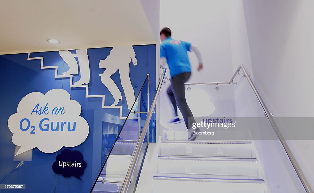 An employee climbs a flight of stairs inside an O2 Mobile Phone Store, part of Telefonica SA, on Grafton Street in Dublin, Ireland, on Wednesday, June 12, 2013. Telefonica SA, Europe's most indebted telephone company, is seeking initial bids for its Irish unit within the month, two people with knowledge of the matter said. Photographer: Aidan Crawley/Bloomberg via Getty Images