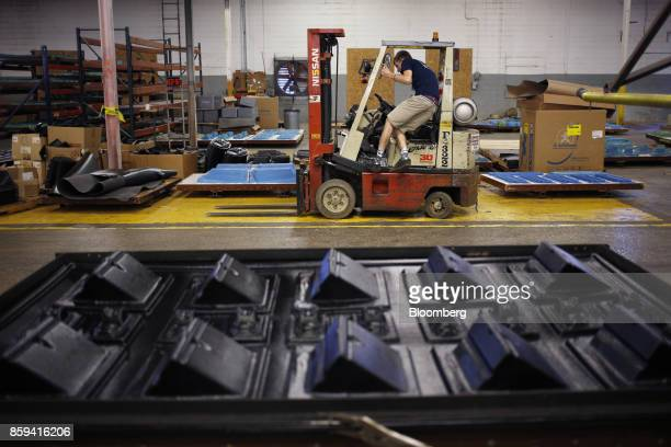 An employee climbs into a forklift at the Jackson Kayak Inc factory in Sparta Tennessee US on Wednesday Oct 4 2017 Durable goods orders for the month...