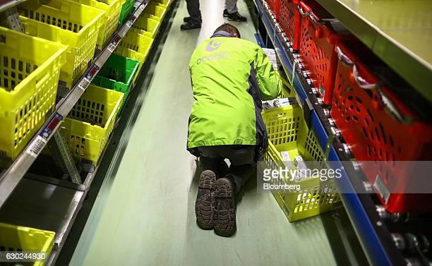 An employee collects an order at the Ocado Group Plc distribution centre in Dordon UK on Friday Dec 16 2016 Ocado provides home delivery of a wide...