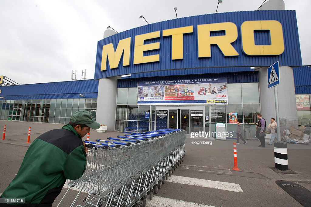 An employee collects trolley carts from the parking lot outside a Metro Cash & Carry store, the Russia unit of Metro AG, in Moscow, Russia, on Friday, Aug. 29, 2014. Metro Cash & Carry has warned that domestic food suppliers are trying to increase some food prices as local produce is substituted for EU, Norwegian and U.S. equivalents which have been sanctioned. Photographer: Andrey Rudakov/Bloomberg via Getty Images