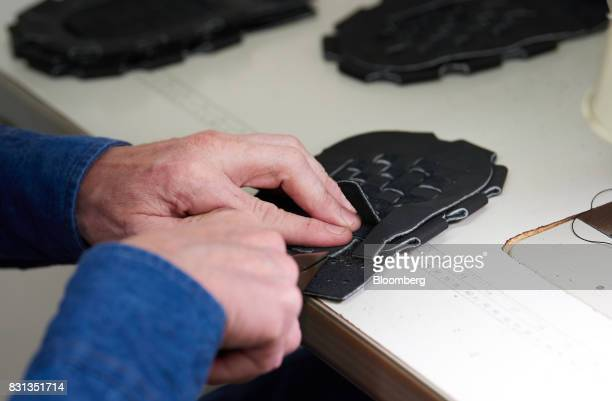 An employee creates the webbing for a ball glove at the Nokona manufacturing facility in Nocona Texas US on Thursday July 27 2017 Since the Great...