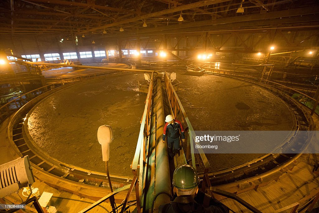 An employee crosses a platform inside the chemical enrichment area of the potash plant operated by OAO Uralkali in Berezniki, Russia, on Monday, Aug. 26, 2013. Russia pressured Belarus to free Vladislav Baumgertner, the head of OAO Uralkali, the world's biggest potash producer, saying a refusal may harm relations as the smaller nation faces a funding crunch. Photographer: Andrey Rudakov/Bloomberg via Getty Images
