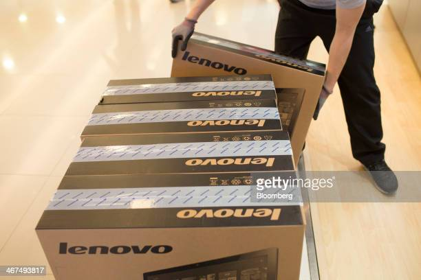 An employee delivers Lenovo Group Ltd computers at a Lenovo store in the Sha Tin district of Hong Kong China on Friday Feb 7 2014 Lenovo which has...