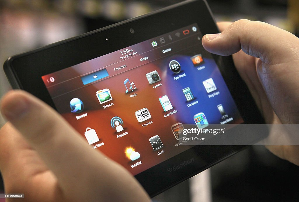 An employee demonstrates a Blackberry Playbook tablet at a Best Buy store on April 19, 2011 in Chicago, Illinois. The tablets, made by Research In Motion, went on sale today in the United States and Canada.