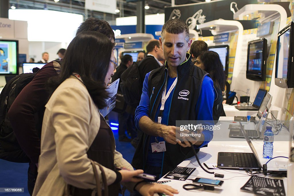 An employee demonstrates a map application on a mobile device at the Intel Corp. pavilion at the Mobile World Congress in Barcelona, Spain, on Tuesday, Feb. 26, 2013. The Mobile World Congress, where 1,500 exhibitors converge to discuss the future of wireless communication, is a global showcase for the mobile technology industry and runs from Feb. 25 through Feb. 28. Photographer: Angel Navarrete/Bloomberg via Getty Images