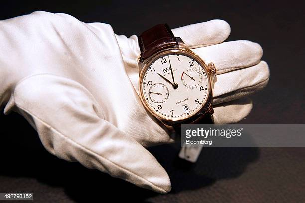 An employee demonstrates an IWC Portugieser Automatic IW500701 rose gold wristwatch at Beyer Chronometrie AG in Zurich Switzerland on Wednesday Oct...