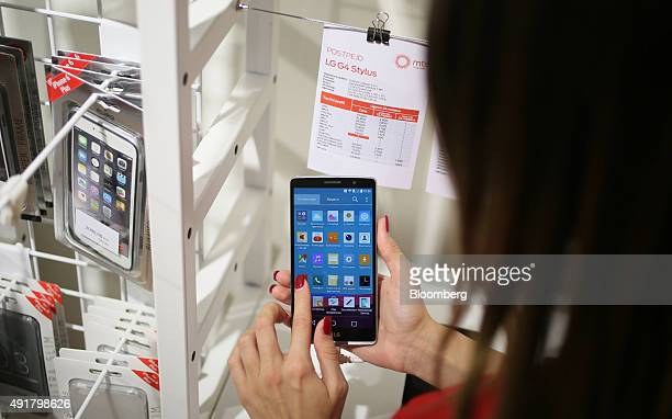 An employee demonstrates an LG Electronics Inc LG G4 Stylus smartphone inside a Telekom Srbija AD mobile phone store in Belgrade Serbia on Wednesday...