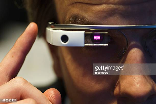 An employee demonstrates how a pair of Google Glass connected glasses are capable of reading barcodes on day three of the Mobile World Congress in...