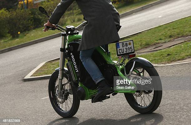 An employee demonstrates the eRockit highpowered electric bicycle outside the company's production site on April 1 2014 in Berlin Germany The eRockit...