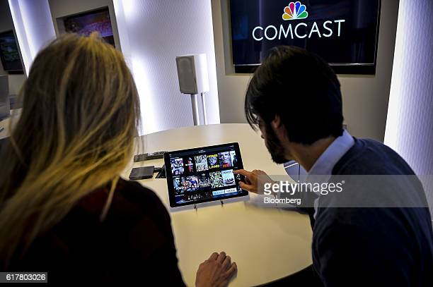 An employee demonstrates the Xfinity app at Comcast Corp headquarters in Philadelphia Pennsylvania US on Monday Oct 24 2016 Comcast Corp is scheduled...