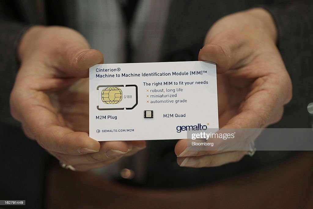 An employee displays a Gemalto NV M2M quad sim card at the Mobile World Congress in Barcelona, Spain, on Wednesday, Feb. 27, 2013. The Mobile World Congress, where 1,500 exhibitors converge to discuss the future of wireless communication, is a global showcase for the mobile technology industry and runs from Feb. 25 through Feb. 28. Photographer: Simon Dawson/Bloomberg via Getty Images