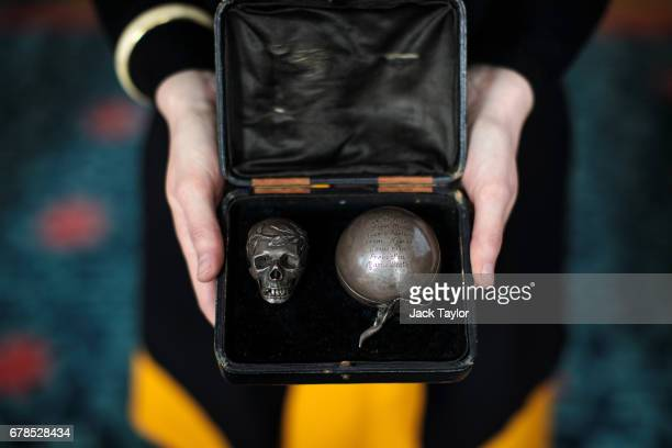An employee displays a Skull Pomander English dated 1626 at 5 Cromwell Place on May 4 2017 in London England British art dealer Oliver Hoare presents...