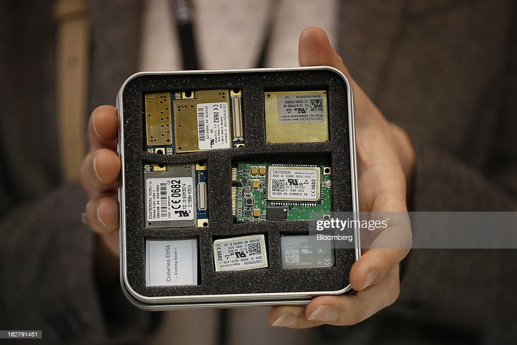 An employee displays a variety of microprocessors in the Gemalto NV pavilion at the Mobile World Congress in Barcelona, Spain, on Wednesday, Feb. 27, 2013. The Mobile World Congress, where 1,500 exhibitors converge to discuss the future of wireless communication, is a global showcase for the mobile technology industry and runs from Feb. 25 through Feb. 28. Photographer: Simon Dawson/Bloomberg via Getty Images