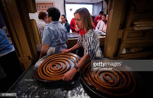 An employee displays 'churros' at the traditional churreria 'La Manueta' on July 13 in Pamplona northern Spain 'La Manueta' a 138 yearold churreria...