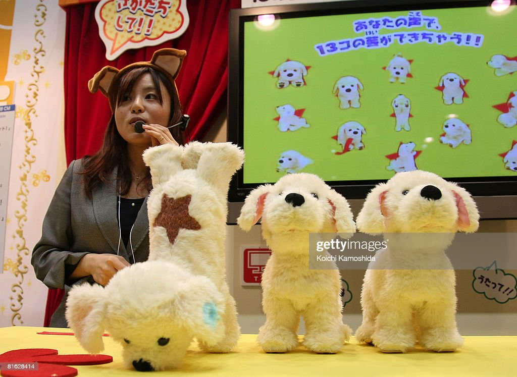 An employee displays Sega Toys' stuffed dog 'Sakadachi Lucky' or 'Handstand Lucky' during the International Tokyo Toy Show 2008 at Tokyo Big Sight on June 19, 2008 in Tokyo, Japan. The show will be held until June 22.
