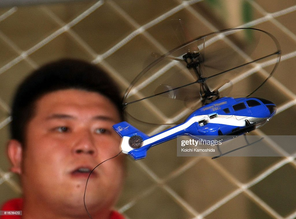 An employee displays the Taiyo RC's MicroMaster HG Mini during the International Tokyo Toy Show 2008 at Tokyo Big Sight on June 19, 2008 in Tokyo, Japan. The 14cm long radio controlled hericopter is on sale at 40 US dollars. 120,000 people are expected to visit the show over the 4 days which has 134 toy manufacturers from both Japan and abroad showing 36,000 products.
