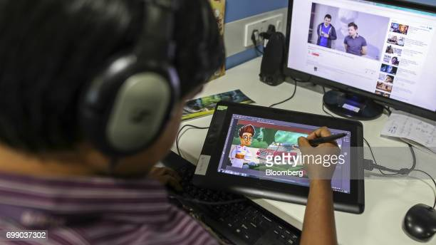An employee draws a cartoon for the BYJU'S learning app in the media department of the Think and Learn Pvt office in Bengaluru India on Wednesday...