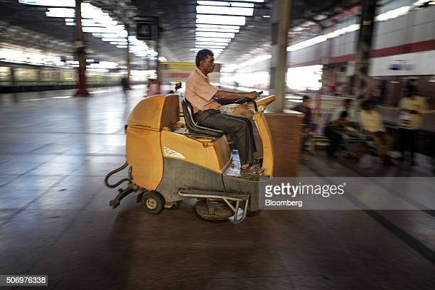 An employee drives a floorcleaning vehicle at Mumbai Central Train Station in Mumbai India on Friday Jan 22 2016 Global investors are keeping faith...