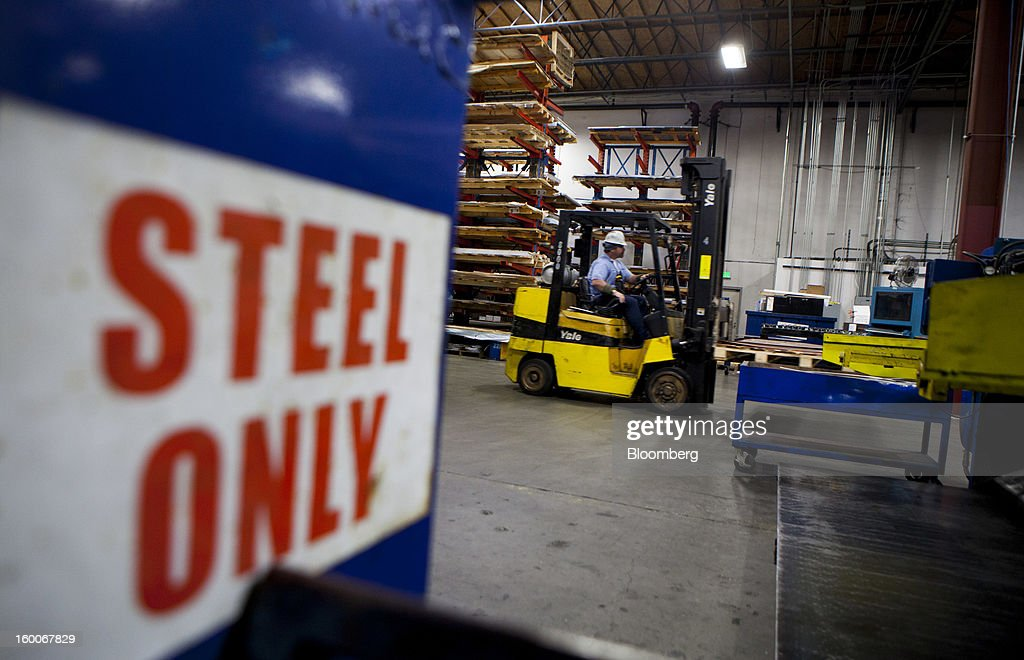 An employee drives a forklift at Industrial Metal Supply Co.'s warehouse in San Diego, California, U.S., on Thursday, Jan. 24, 2013. Industrial Metal Supply Co. is an aluminum, steel and sheet metal supplier serving businesses and retail custmers. Photographer: Sam Hodgson/Bloomberg via Getty Images