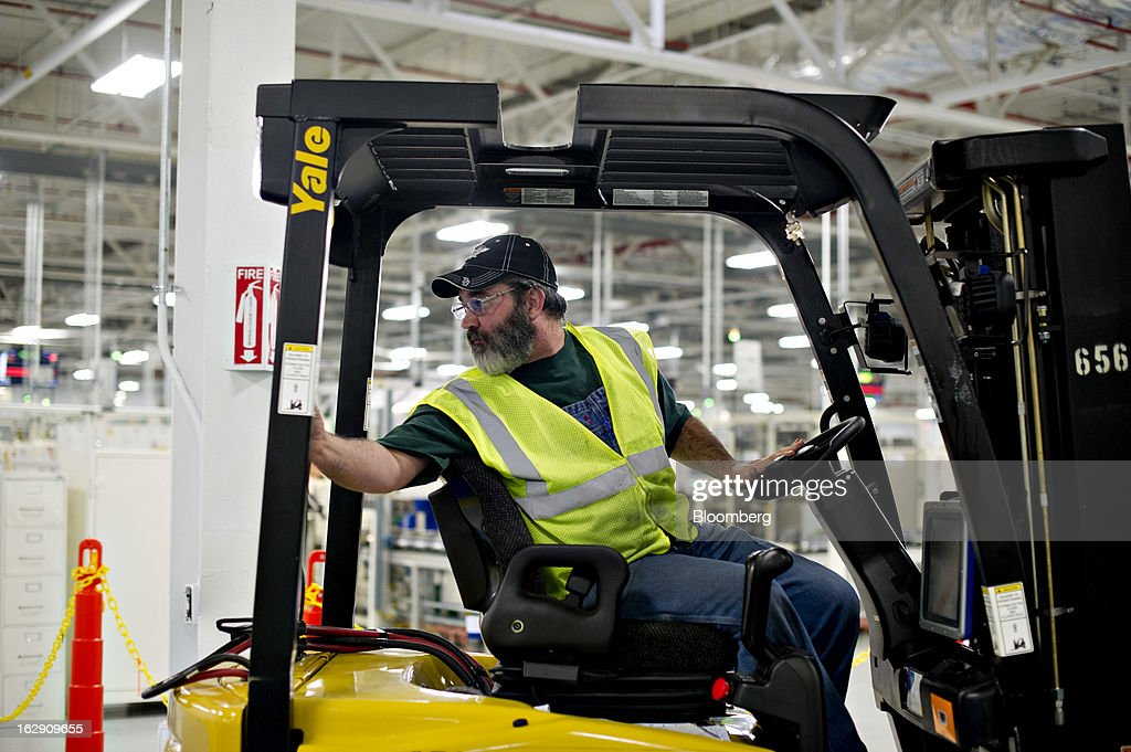 An employee drives a forklift at the Chrysler Group transmission plant in Kokomo, Indiana, U.S., on Thursday, Feb. 28, 2013. Chrysler Group LLC, the automaker majority owned by Fiat SpA, will invest about $374 million and add 1,250 jobs at Indiana factories to boost output of eight-and nine-speed transmissions. Photographer: Daniel Acker/Bloomberg via Getty Images