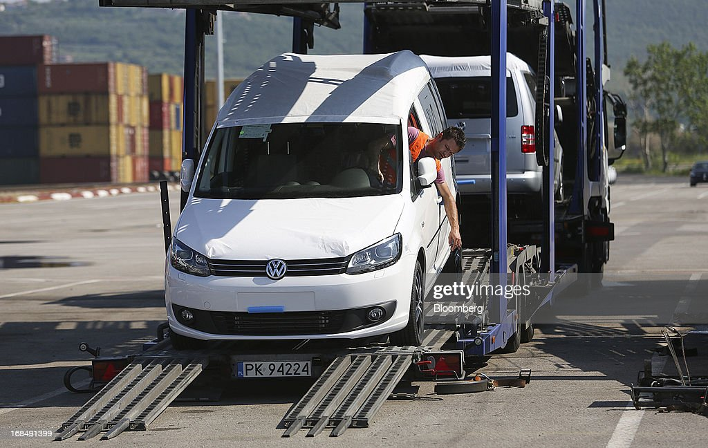 An employee drives a new Volkswagen AG Caddy automobile from a transport truck at the port of Koper, operated by Luka Koper d.d., in Koper, Slovenia, on Thursday, May 9, 2013. The former Yugoslav nation, mired in its second recession since 2009, will contract this year and next, according to a May 3 report by the European Commission. Photographer: Chris Ratcliffe/Bloomberg via Getty Images