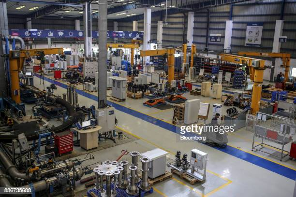 An employee drives a rideon vacuum sweeper through the Grundfos AS factory in Chennai India on Monday Nov 27 2017 Nicknamed the 'Detroit of India'...