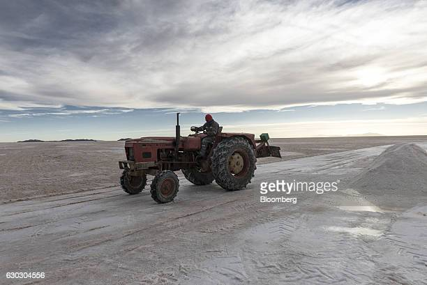 An employee drives a tractor across the Salar de Uyuni in Potosi Bolivia on Sunday Dec 11 2016 Bolivia has the largest lithium deposits of any...