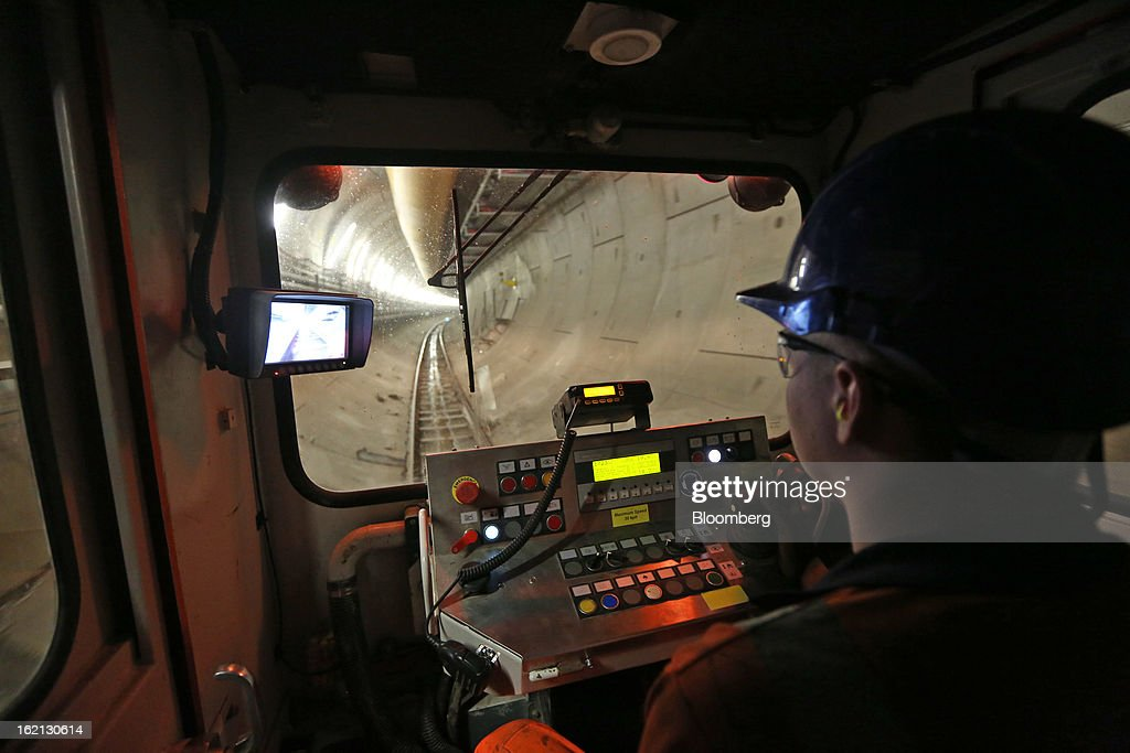 An employee drives a works locomotive through one of new western tunnels, developed by Crossrail, beneath London, U.K., on Tuesday, Feb. 19, 2013. Network Rail Ltd. projects include a 6 billion-pound upgrade to the Thameslink line that spans London from north to south and the Crossrail project to build an east-west line through the capital, Finance Director Patrick Butcher said. Photographer: Chris Ratcliffe/Bloomberg via Getty Images