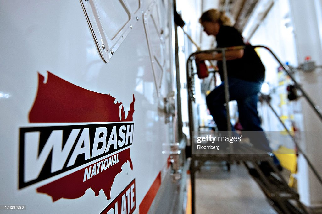 An employee enters a semi trailer to perform an inspection at the Wabash National Corp. facility in Lafayette, Indiana, U.S., on Monday, July 22, 2013. Wabash National Corp. is scheduled to release earnings figures on July 30. Photographer: Daniel Acker/Bloomberg via Getty Images