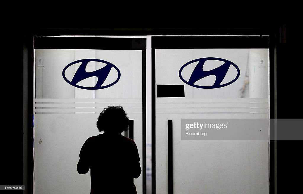 An employee enters an office at the Hyundai Motor Co. plant during a strike by the company's labor union in Ulsan, South Korea, on Tuesday, Aug. 20, 2013. Union members at Hyundai Motor, South Korea's largest automaker, staged a partial strike today that will continue tomorrow as they demand higher wages amid increasing competition with Japanese carmakers. Photographer: SeongJoon Cho/Bloomberg via Getty Images