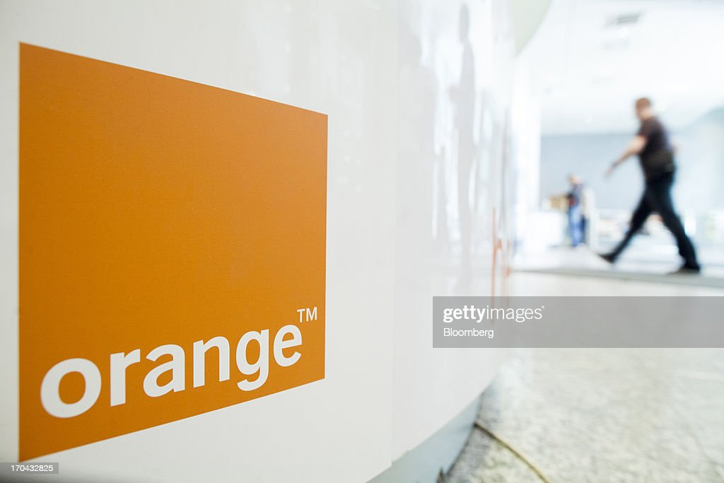 An employee enters the headquarters of Orange Polska, also known as Telekomunikacja Polska SA (TPSA), Poland's national telecommunications company, in Warsaw, Poland, on Wednesday, June 12, 2013. Cable providers are being drawn to Poland, the European Union's biggest eastern economy, because penetration levels are half that of neighboring Germany even as unemployment rises, according to a website presentation by the country's biggest TV network, Cyfrowy Polsat SA. Photographer: Bartek Sadowski/Bloomberg via Getty Images