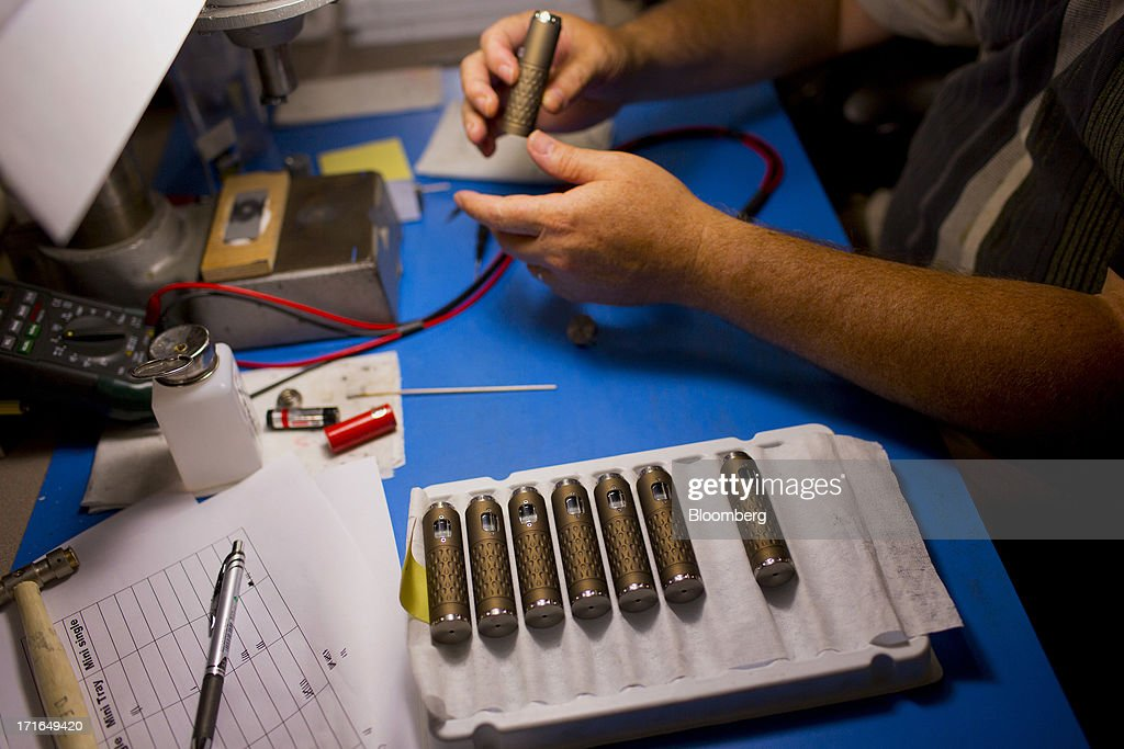 An employee executes final assembly and testing on ProVari model electronic cigarettes at the ProVape Inc. facility in Monroe, Washington, U.S., on Wednesday, June 26, 2013. U.S. sales of electronic cigarettes are estimated to double in 2013 from last year, to $1 billion, according to estimates made by the Tobacco Merchants Association (TMA) and Mintel. Photographer: Mike Kane/Bloomberg via Getty Images