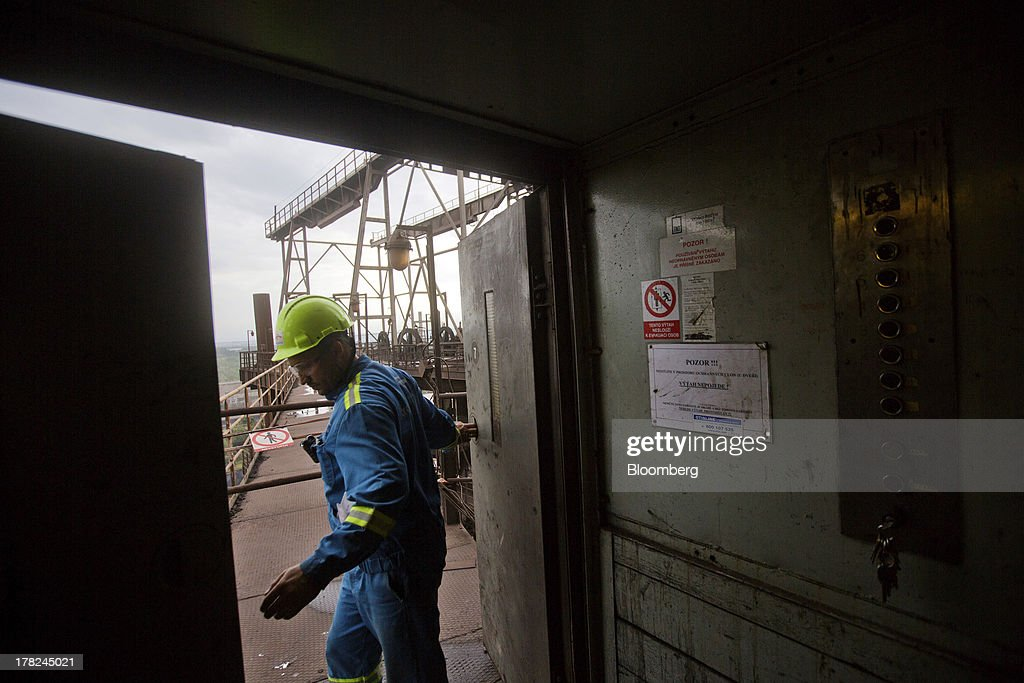An employee exits a lift onto a walkway above ArcelorMittal's steel plant in Ostrava, Czech Republic, on Monday, Aug. 26, 2013. ArcelorMittal, the world's biggest steelmaker, said steel shipments will rise 1 percent to 2 percent this year compared with an earlier forecast of 2 percent in May. Photographer: Martin Divisek/Bloomberg via Getty Images