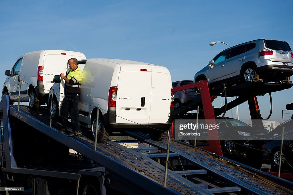 An employee exits a new imported PSA Peugeot Citroen SA Bipper van after driving it onto a transporter truck for shipping at Barcelona port in Barcelona, Spain, on Thursday, Jan. 10, 2013. Spanish exports grew the least in five months in September as the euro area relapsed into a recession and the region's fourth-largest economy continued to contract. Photographer: David Ramos/Bloomberg via Getty Images