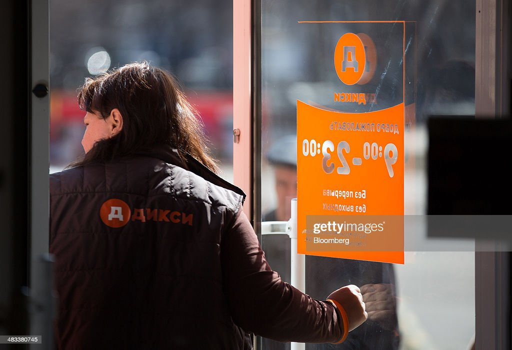 An employee exits the entrance door to a Dixy supermarket operated by OAO Dixy Group in Moscow, Russia, on Tuesday, April 8, 2014. Suppliers suffering from ruble depreciation this quarter are urging retailers to increase prices. Photographer: Andrey Rudakov/Bloomberg via Getty Images