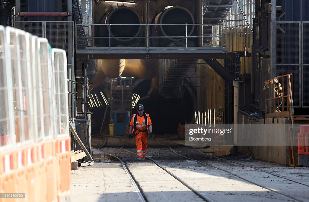 An employee exits the entrance to the two western Crossrail tunnels at the Westbourne Park construction site in London, U.K., on Tuesday, Feb. 19, 2013. Network Rail Ltd. projects include a 6 billion-pound upgrade to the Thameslink line that spans London from north to south and the Crossrail project to build an east-west line through the capital, Finance Director Patrick Butcher said. Photographer: Chris Ratcliffe/Bloomberg via Getty Images