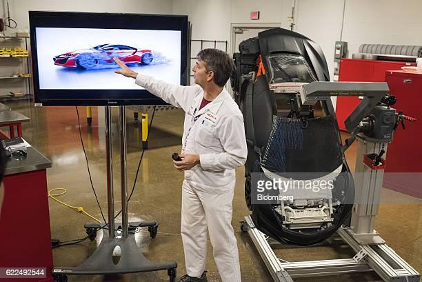 An employee explains aerodynamics testing on the Honda Motor Co 2017 Acura NSX vehicle at the Honda Auto Plant in Marysville Ohio US on Thursday Nov...