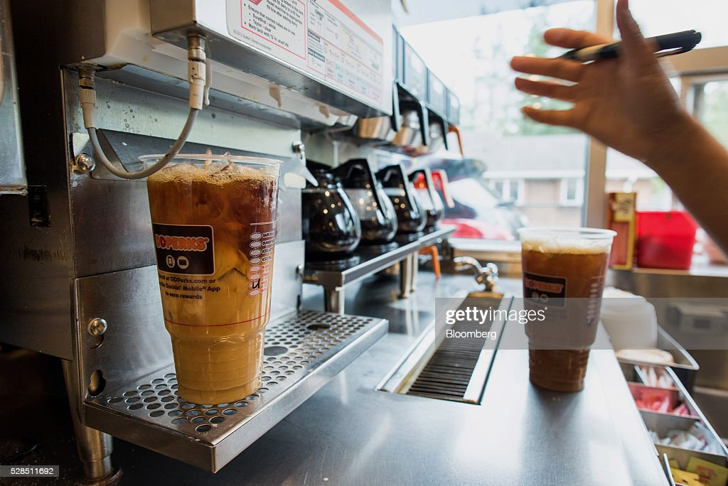 An employee fills a coffee order at a Dunkin' Donuts Inc. location in Ramsey, New Jersey, U.S., on Thursday, May 5, 2016. Dunkin' Brands Group Inc., a leading franchiser in the quick service restaurants (QSR) sector, operates in almost 60 countries around the world with more than 11,300 Dunkin' Donuts restaurants and 7,500 Baskin-Robbins locations. Photographer: Ron Antonelli/Bloomberg via Getty Images