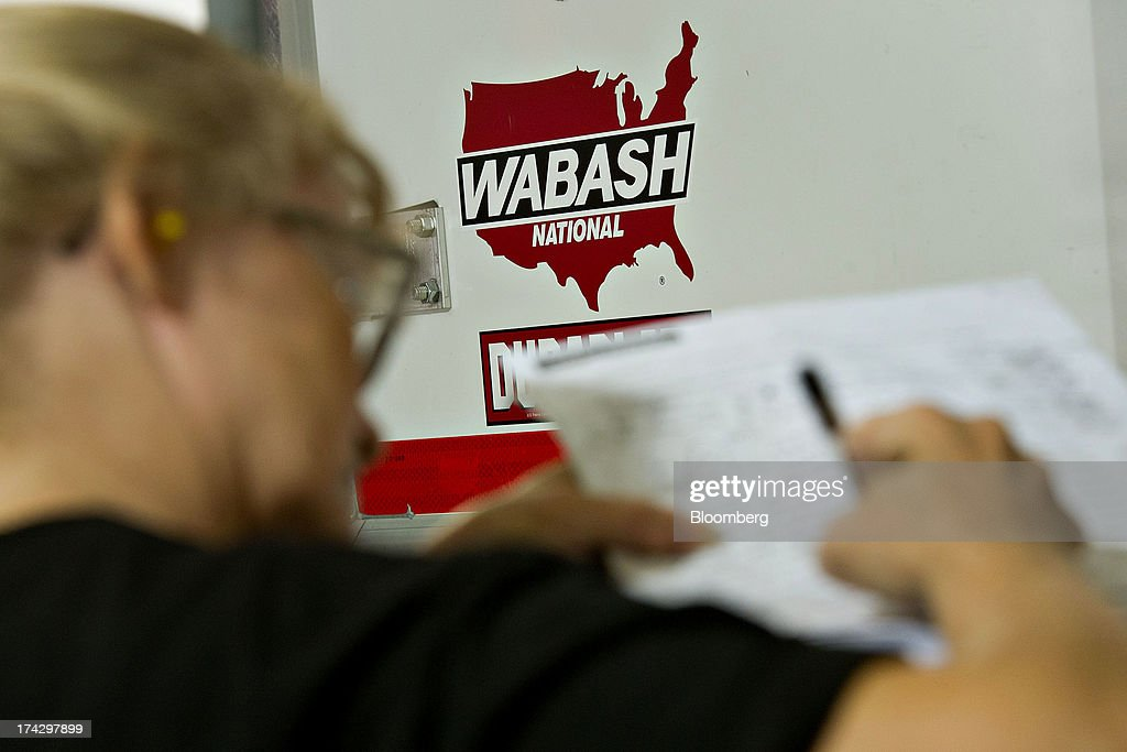 An employee fills out an inspection report at the Wabash National Corp. facility in Lafayette, Indiana, U.S., on Monday, July 22, 2013. Wabash National Corp. is scheduled to release earnings figures on July 30. Photographer: Daniel Acker/Bloomberg via Getty Images