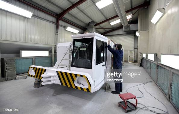An employee fits a part to an aviation towing tractor at the Douglas Equipment plant owned by CurtissWright Corp in Cheltenham UK on Tuesday April 17...