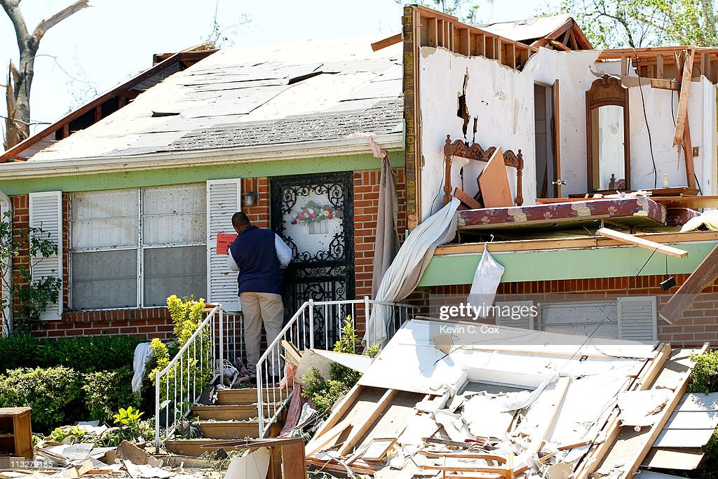 An employee for the City of Birmingham Department of Planning, Engineering and Permits staples a 'KEEP OUT' notice on a home on Chaucer Street that was destroyed by tornadoes on April 29, 2011 in Pratt City, Alabama. Alabama, the hardest-hit of six states, is reported to have had nearly 300 deaths as a result of the storms.