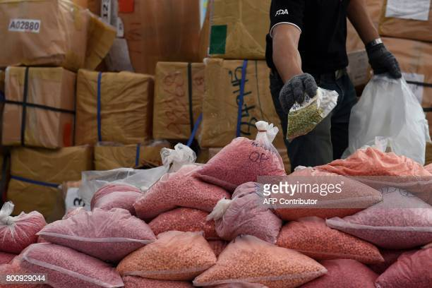 An employee from the Food and Drug Administration sorts out bags of methamphetamines before their incineration during the 47th Destruction of...