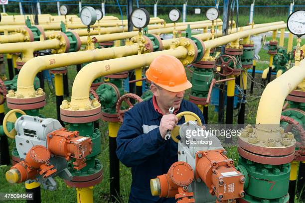 An employee from UkrTransGaz checks gas pipes at the Dashava underground gas storage facility operated by UkrTransGaz a unit of NAK Naftogaz Ukrainy...